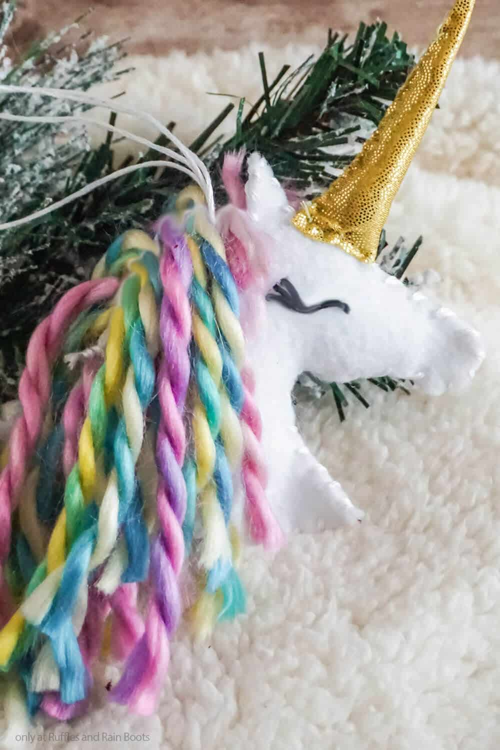 closeup of fun DIY holiday ornament unicorn felt ornament