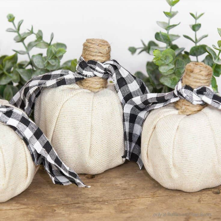 three fabric covered pumpkins made with supplies from the dollar tree