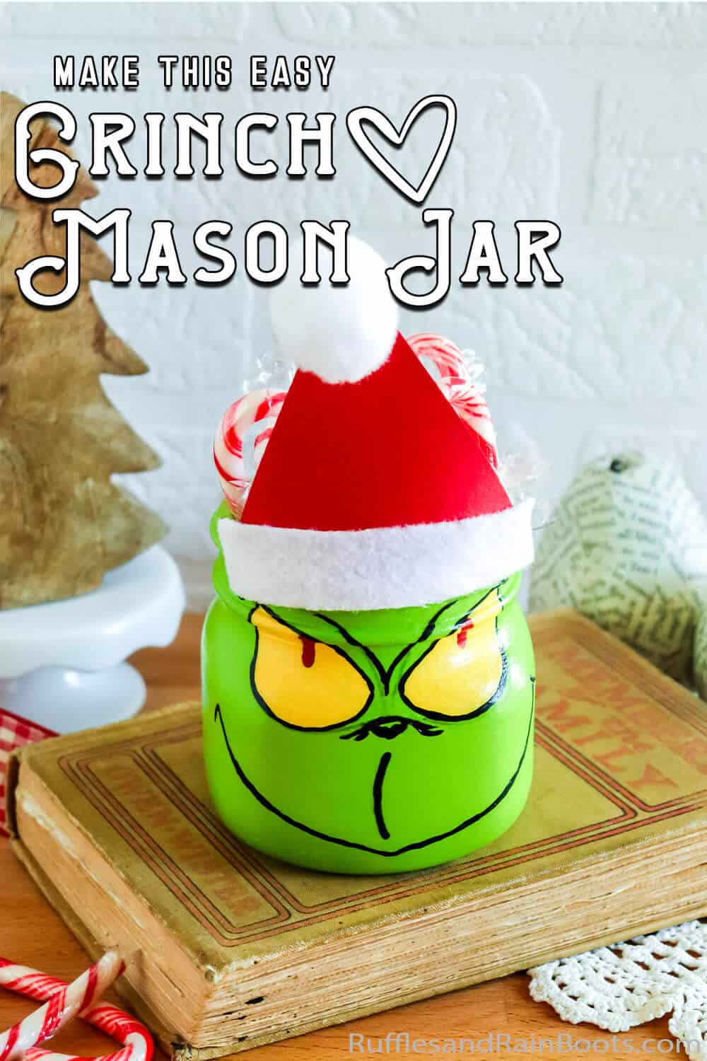 easy painted mason jar craft for a gift with text which reads make this easy grinch mason jar