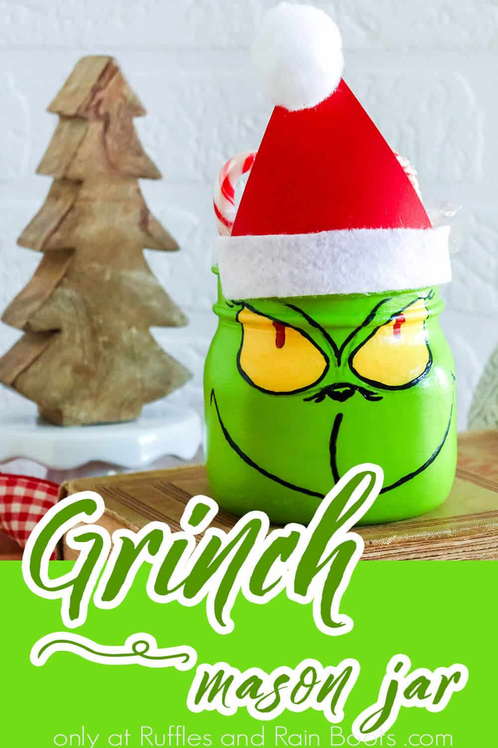 closeup of easy holiday craft with text which reads grinch mason jar