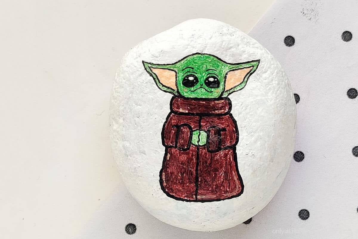 closeup of easy star wars painted rock kids craft with baby yoda painted rock