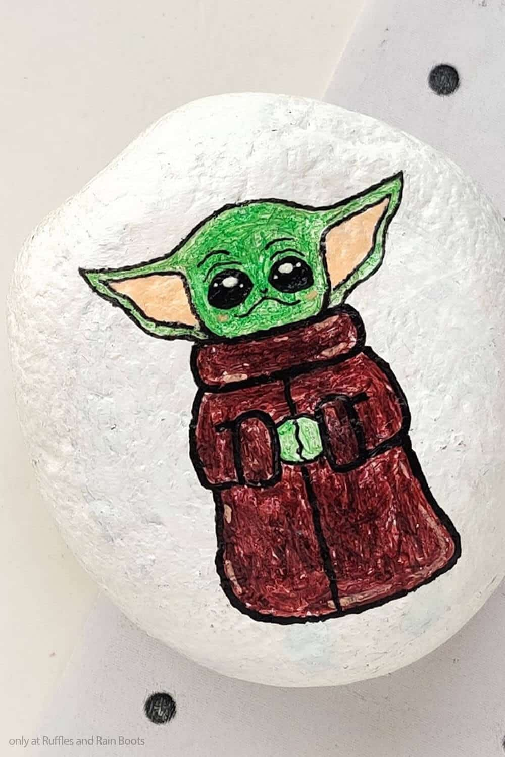 closeup of easy diy star wars painted rock craft with baby yoda