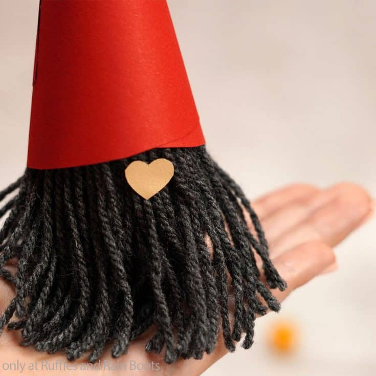 hand holding a paper tube gnome kids craft