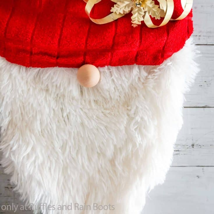 closeup of easy no-sew gnome wreath from a dollar store witch hat form