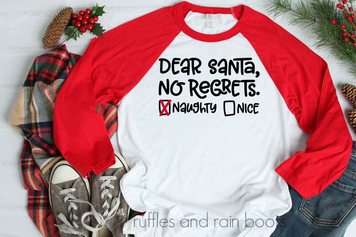 Dear Santa SVG No Regrets Naughty List on a tshirt laying on a table