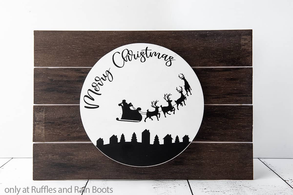 merry christmas scene cut file set on a wood round sign