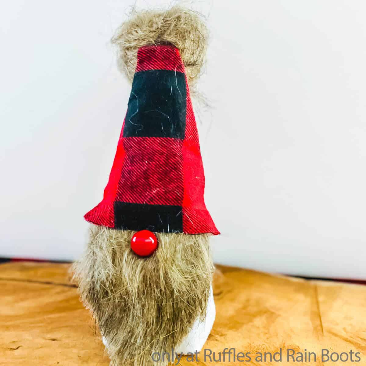 easy dollar tree gnome craft made from a cup