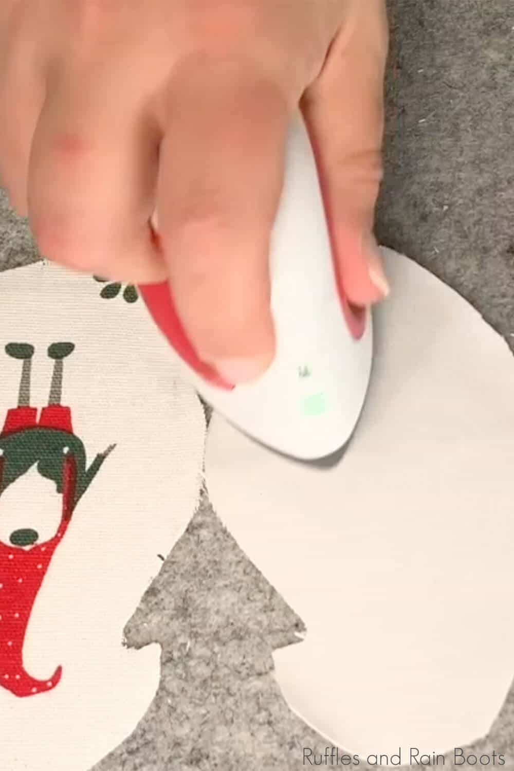 in-process step of ironing fabric to make a napkin ornament tutorial